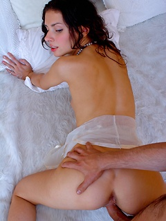 Delicious brunette lassie deepthroats a stiff cock before taking a ride on it