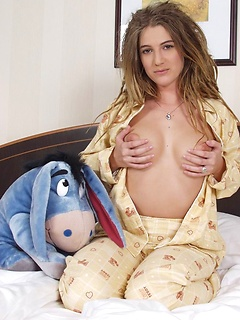 Solo girl with dreadlocks models pajamas and sexy panties in her hotel room
