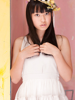 Stunning Japanese beauty Tomoe Yamanaka poses erotically in her white lingerie