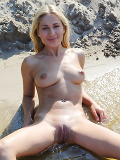 Smoking hot blonde bombshell Candice B poses in the nude on the river bank