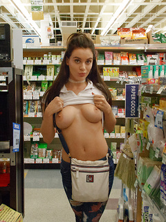 Big-boobed stunner Lana Rhoades reveals her huge tits and round ass in a store