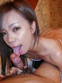 Cute Oriental minx sucks on her man's thick shaft before being pounded with it
