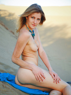 Sweet chick Mila I gets rid off the clothes while she poses in the desert