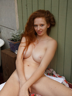 Sweet redhead babe unveils her smoking hot body while relaxing in the bathtub