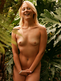 Foxy young blonde squats down in the middle of a jungle in order to pee