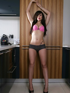 Tattooed Autumn Riley likes to get naked in her free time and pose in a kitchen