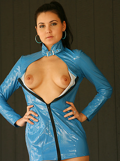 Big hoop earrings and a blue latex dress are stunning on a brunette babe
