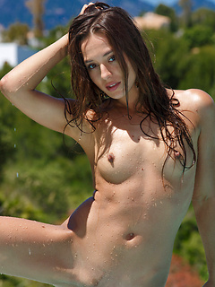 Beautiful model Dominika is on vacation and stripping from her skimpy bikini poolside