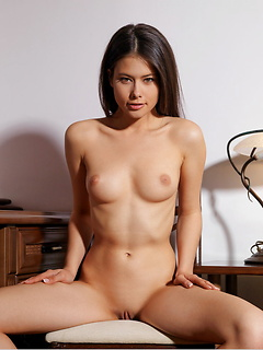 Adorable young honey Jackie D removes her red dress and poses sensually
