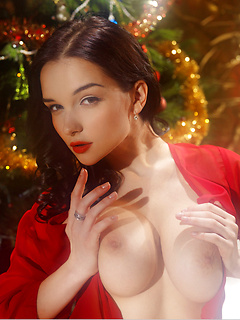 Celebrate the sexiest Christmas ever with big breasts brunette model Jenya as she teases