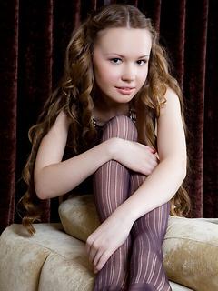 Skinny teen is flawlessly beautiful in her soft purple stockings