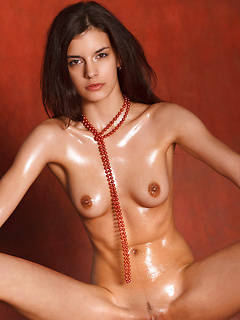Euro girl Candice Luka models her tight oiled up body in erotic solo pictures