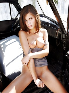 Naked Caprice climbs in the front seat of the classic truck to show off her twat