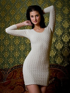 Sexy sweater dress fits tight on the lean and leggy body of a Euro beauty