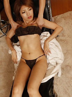Pretty Japanese girl undresses sensually for a foot massage and dildo play