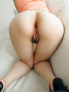 Asian ass in a little black thong with pink ruffles makes the mouth water