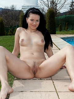Solo beauty Kylie plays naked poolside and spreads her legs wide so you can see her pussy
