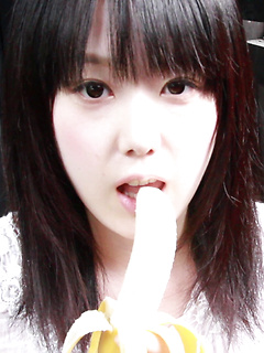 Machiko peels a banana and takes it into her mouth like a cock for tease pics