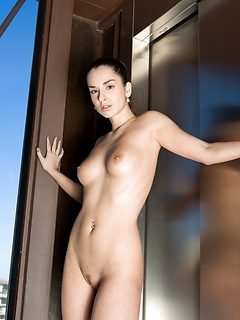Nude beauty with a long ponytail has a perfect pair of little tits and lovely legs