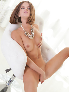 Slim brunette looker Talinka removes her clothes and fingers her delicious cunt