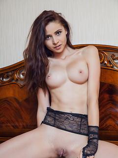 Ravishing brunette hottie in lace lingerie Red Fox exposes her tight body