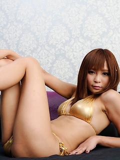 Shiny gold bikini looks blazing hot on Japanese model Sayuri Ono