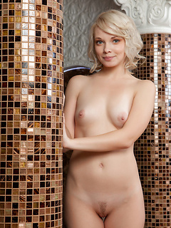 Sexy blonde babe Feeona A removes her clothes and takes a relaxing bath