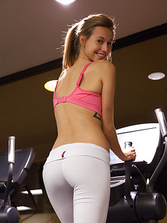 Sporty smiling model Geri Burgess looks amazing in skintight white workout pants
