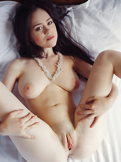 Sweet brunette Annis invites you to bed to ogle her big natural breasts