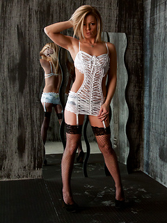 Fishnet stockings and wicked hot white lace lingerie make Madden a perfect babe