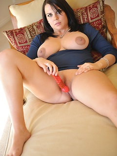 Julie has her amazing big natural tits exposed as she masturbates her cunt