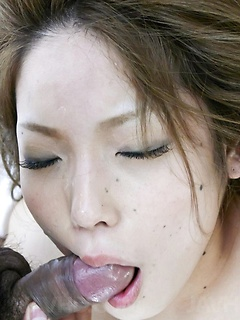 Hardcore Japanese threesome with two guys using her mouth and pussy and cumming inside her