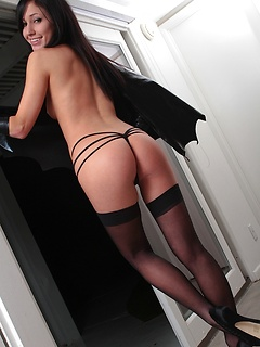 Sexy Batgirl costume looks hot on slender brunette solo girl Catie Minx