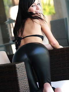 Black wet look leggings cling to the tight ass of Catie Minx