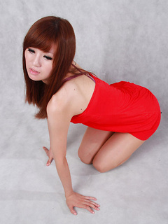 Japanese glamour babe looks perfect in her little red dress and high heels