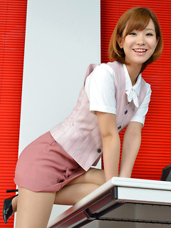 Hot Asian looker Ichika Nishimura teases while wearing a rather tight mini-skirt