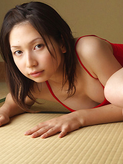 Adorable Japanese cutie Kaori Ishii poses while wearing a red swimming suit