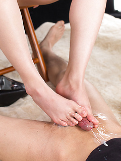 Japanese secretary in a skirt and heels gives her boss a footjob and makes him cum