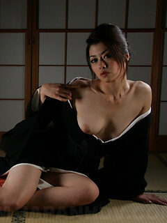 Japanese girl sensually opens her kimono and bares her small natural tits