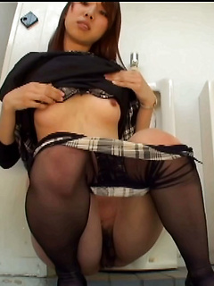 Asian drops her pantyhose in the public bathroom so she can masturbate solo