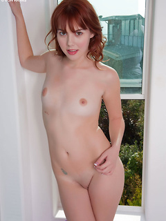 Petite redhead sweetheart Delila Darling gets to remove her purple panties
