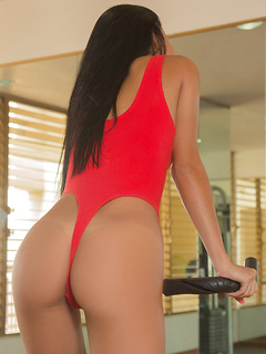 Leggy Latina babe Denisse Gomez is sizzling hot in her red one piece thong swimsuit