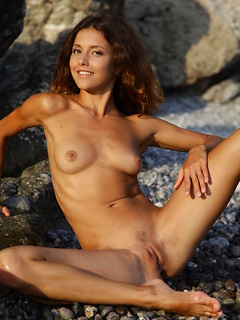 Sensual cutie Divina A loves exposing her steaming hot body at a rocky beach