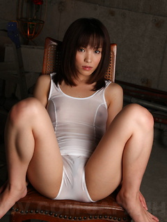 Smoking hot Asian girl likes to pose on the chair while she strips down