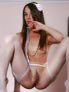 Sexy white stockings and a skimpy outfit make it easy for this lithe young model to arouse you