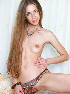 Flawlessly beautiful skinny girl in an expensive bra and panty set strips to tease you