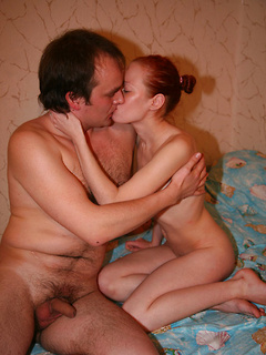 Cute Russian redhead gets frisky with a couple of guys and they spit roast her